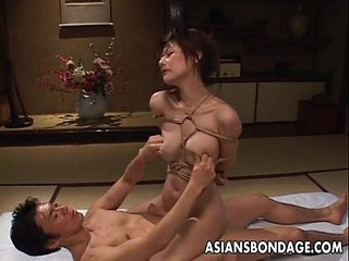 Tempting Asian babe in bondage gets screwed hard